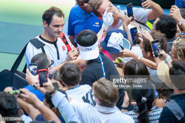 Open Tennis Tournament- Day Five. Roger Federer of Switzerland signing autographs after his victory against Daniel Evans of Great Britain in the...