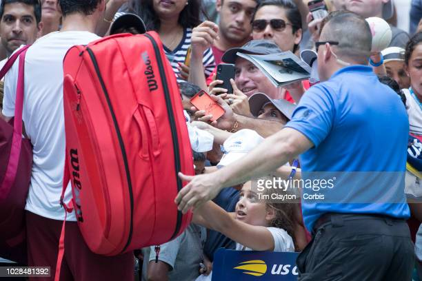 Open Tennis Tournament Day Four A Young fan attempts to get an autograph from Roger Federer of Switzerland after his match against Benoit Paire of...