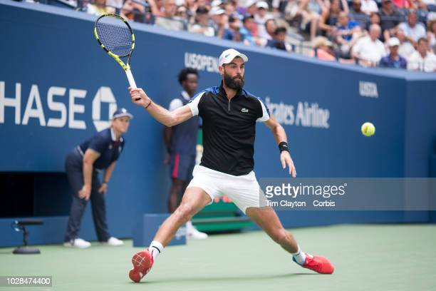 Open Tennis Tournament Day Four Benoit Paire of France in action against Roger Federer of Switzerland in the Men's Singles round two match on Arthur...