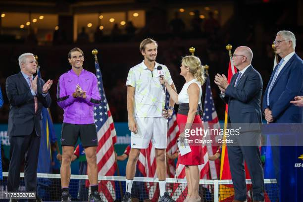 Open Tennis Tournament Day Fourteen Danill Medvedev of Russia is interviewed by Chris McKendry of ESPN at the trophy presentation ceremony after his...