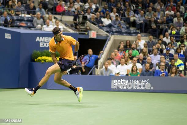 Open Tennis Tournament Day Fourteen Juan Martin Del Potro of Argentina plays a shot through his legs during his match against Novak Djokovic of...