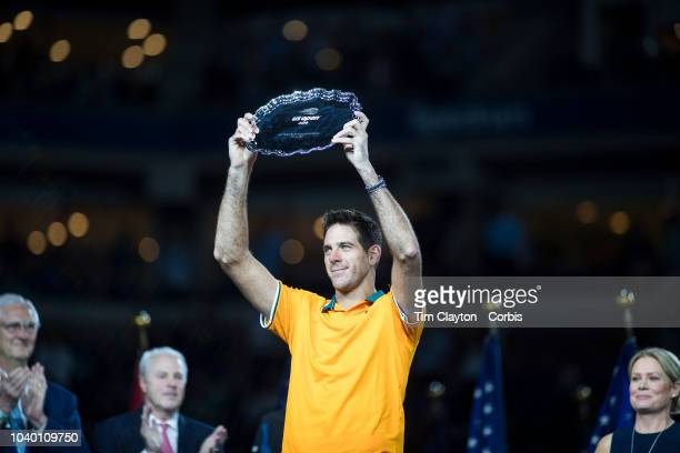 Open Tennis Tournament Day Fourteen Juan Martin Del Potro of Argentina with the runners up trophy after his match against Novak Djokovic of Serbia in...