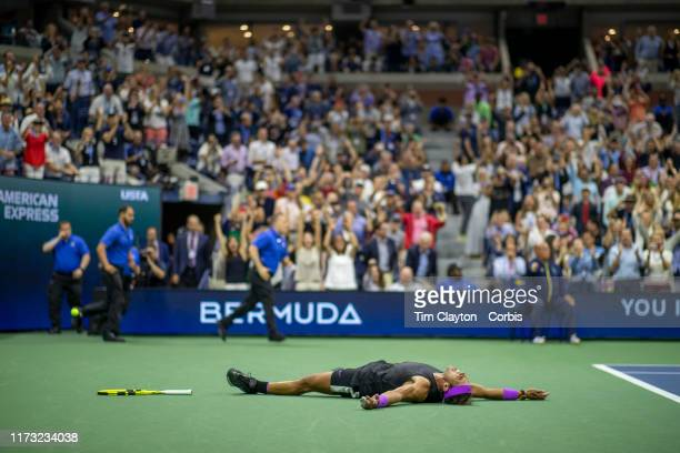 Open Tennis Tournament- Day Fourteen. Rafael Nadal of Spain lays on the court to celebrate his five set win against Danill Medvedev of Russia in the...