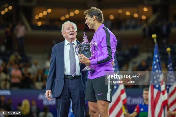 Open Tennis Tournament Day Fourteen Rafael Nadal of Spain with the winners trophy and tennis legend Rod Laver who presented the trophy after his...