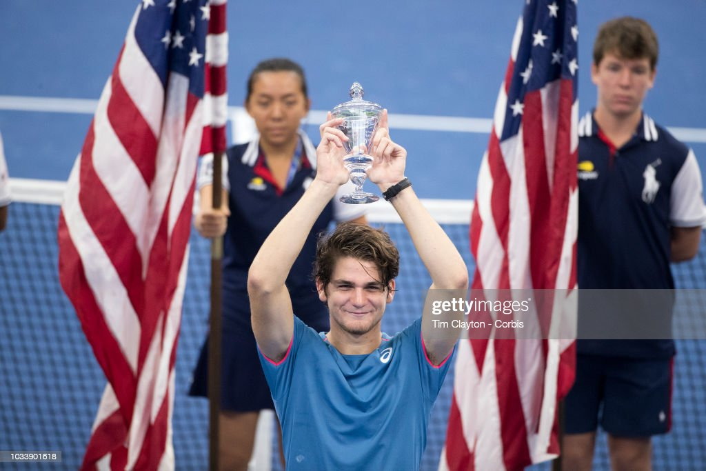 Open Tennis Tournament- Day Fourteen. Thiago Seyboth Wild of Brazil with the trophy after his victory against Lorenzo Musetti of Italy in the Junior Boys' Singles Final at Louis Armstrong Stadium at the 2018 US Open Tennis Tournament at the USTA Billie Jean King National Tennis Center on September 8th, 2018 in Flushing, Queens, New York City.