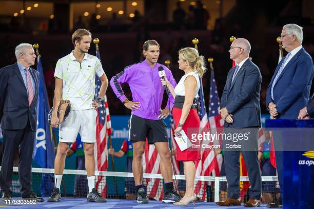 Open Tennis Tournament Day Fourteen Winner Rafael Nadal of Spain is interviewed by Chris McKendry of ESPN at the trophy presentation ceremony after...