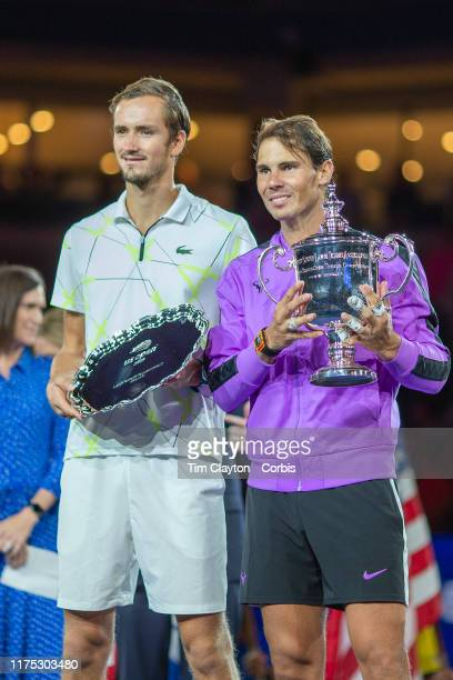 Open Tennis Tournament Day Fourteen Winner Rafael Nadal of Spain with the winners trophy and Danill Medvedev of Russia with the runners up trophy...