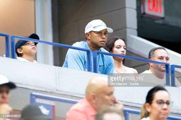 Open Tennis Tournament Day Nine Golfer Tiger Woods watching Serena Williams of the United States in action against Qiang Wang of China in the Women's...
