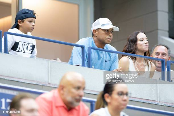 Open Tennis Tournament- Day Nine. Golfer Tiger Woods watching Serena Williams of the United States in action against Qiang Wang of China in the...