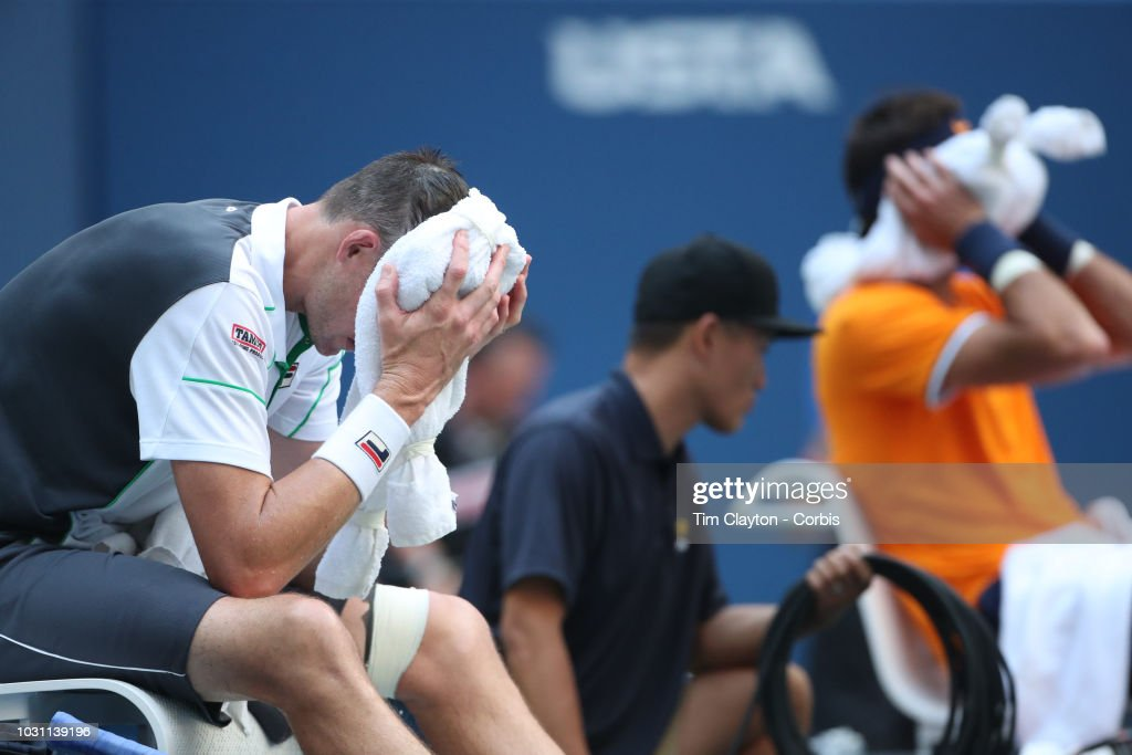 Open Tennis Tournament- Day Nine. John Isner of the United States cools down between game during his match against Juan Martindel Potro of Argentina in the Men's Singles Quarter Finals match on Arthur Ashe Stadium at the 2018 US Open Tennis Tournament at the USTA Billie Jean King National Tennis Center on September 4th, 2018 in Flushing, Queens, New York City.