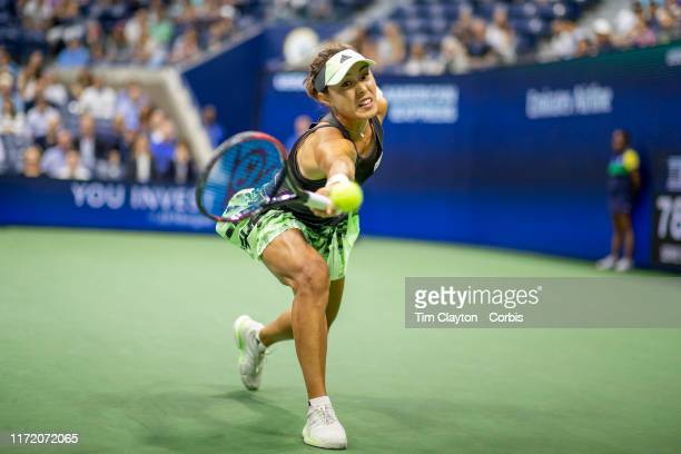 Open Tennis Tournament Day Nine Qiang Wang of China attempt to reach a shot from Serena Williams of the United States in the Women's Singles...