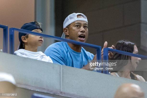 Open Tennis Tournament Day Nine Tiger Woods watching Serena Williams of the United States in action against Qiang Wang of China in the Women's...