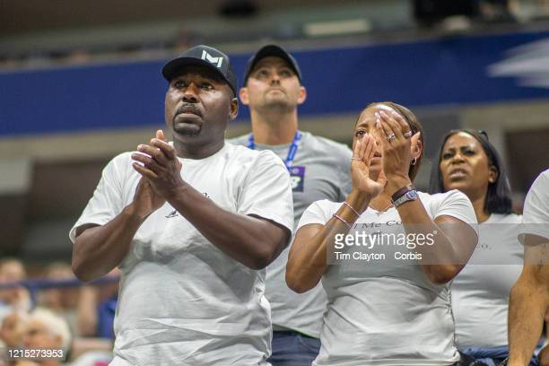 Open Tennis Tournament Day Six Candi Gauff and Corey Gauff parents of Coco Gauff of the United States encourage her during her match against Naomi...