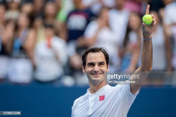 Open Tennis Tournament Day Six Roger Federer of Switzerland hits signed tennis balls into the crowd after his victory against Nick Kyrgios of...
