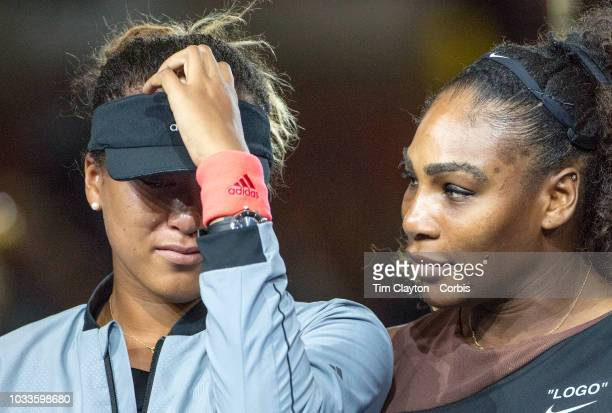 Open Tennis Tournament Day Thirteen A tear rolls down the cheek of winner Naomi Osaka of Japan as she is hugged by Serena Williams of the United...