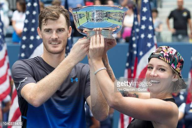 Open Tennis Tournament- Day Thirteen. Bethanie Mattek-Sands of the United States and Jamie Murray of the United Kingdom celebrate with the trophy...