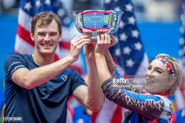 Open Tennis Tournament- Day Thirteen. Bethanie Mattek-Sands of the United States and Jamie Murray of Great Britain with the winners trophy after...