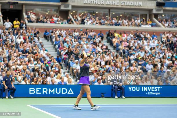 Open Tennis Tournament Day Thirteen Bianca Andreescu of Canada drops her racquet at match point as she celebrates her victory against Serena Williams...