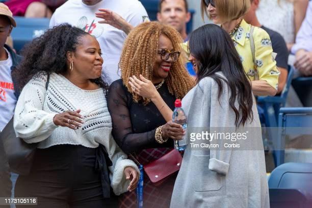 Open Tennis Tournament Day Thirteen Meghan Markle Duchess of Sussex is greeted by Oracene Price mother of Serena Williams and Isha Price sister of...