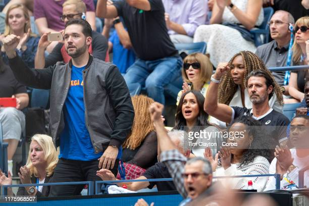 Open Tennis Tournament- Day Thirteen. Meghan Markle, Duchess of Sussex reacts while watching Serena Williams of the United States in action against...