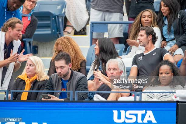 Open Tennis Tournament Day Thirteen Meghan Markle Duchess of Sussex in conversation while watching Serena Williams of the United States in action...