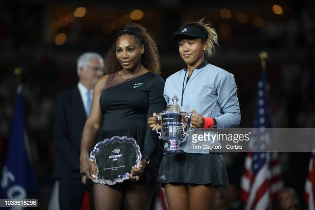 Open Tennis Tournament Day Thirteen Naomi Osaka of Japan with the winners trophy and Serena Williams of the United States with the runners up trophy...