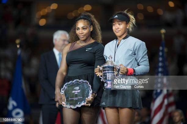 Open Tennis Tournament- Day Thirteen. Naomi Osaka of Japan with the winners trophy and Serena Williams of the United States with the runners up...