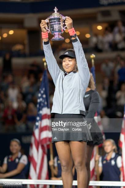 Open Tennis Tournament Day Thirteen Naomi Osaka of Japan with the winners trophy during presentations after her victory against Serena Williams of...