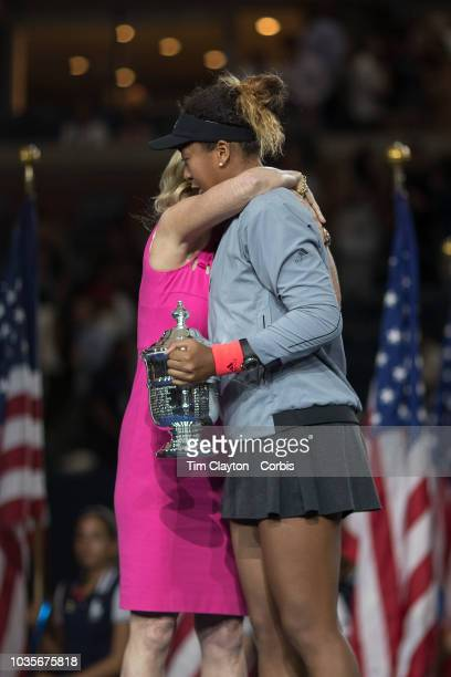 Open Tennis Tournament Day Thirteen Naomi Osaka of Japan with the winners trophy receives a hug from Chris Evert during presentations after her...