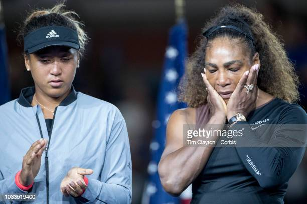 Open Tennis Tournament Day Thirteen Serena Williams of the United States reaches at the presentations after her loss amid controversy against Naomi...