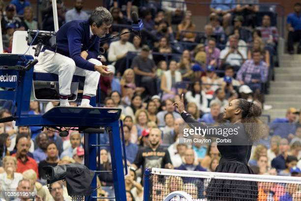 Open Tennis Tournament Day Thirteen Serena Williams of the United States reacts after receiving a one game penalty from chair umpire Carlos Ramos...