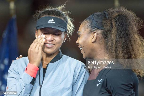Open Tennis Tournament Day Thirteen Winner Naomi Osaka of Japan in tears alongside Serena Williams of the United States at the presentations after...