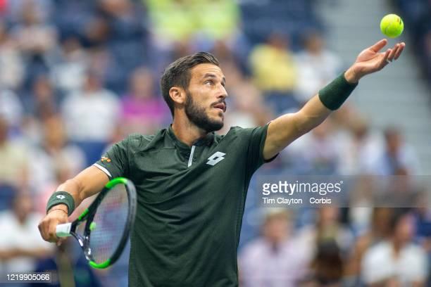 Open Tennis Tournament- Day Three. Damir Dzumhur of Bosnia and Herzegovina in action against Roger Federer of Switzerland in the Men's Singles Round...