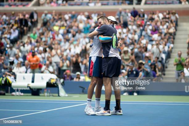 Open Tennis Tournament Day Twelve Jack Sock and Mike Bryan of the United States celebrate winning the Men's Doubles Final against Lukasz Kubot of...