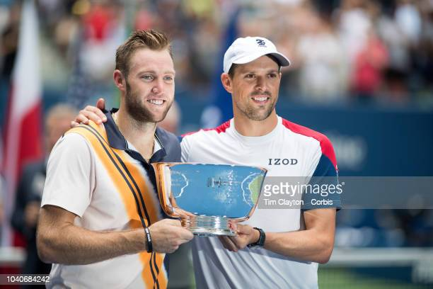 Open Tennis Tournament Day Twelve Jack Sock and Mike Bryan of the United States celebrate with the trophy after winning the Men's Doubles Final...