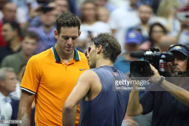 Open Tennis Tournament Day Twelve Rafael Nadal of Spain is consoled by Juan Martin Del Potro of Argentina after Nadal retired injured after the...