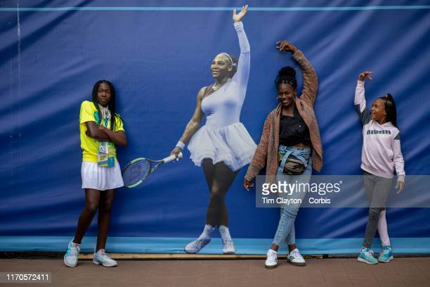 Open Tennis Tournament Day Two Fans young and old pose with a life size photograph of Serena Williams Life size photographs of the stars of tennis...