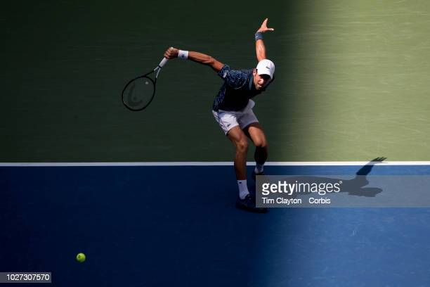 Open Tennis Tournament Day Two NovakDjokovic of Serbia in action against MartonFucsovics of Hungary in the Men's Singles round one match on Arthur...