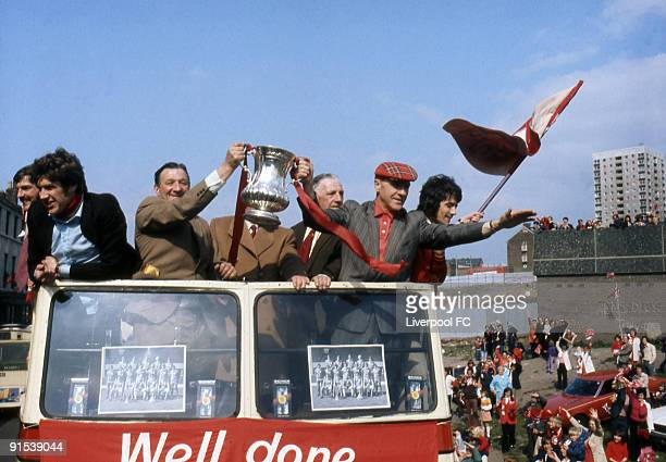 Open top bus parade with the 1974 FA Cup moving down Everton Valley onto Scotland Road with on the bus Liverpool players Steve Heighway Emlyn Hughes...