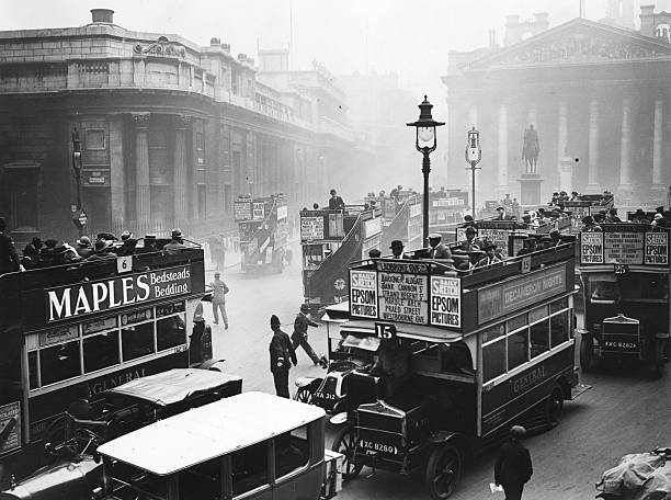 Open top buses converge near the Bank of England in...