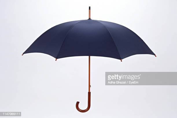 open umbrella against white background - umbrella stock pictures, royalty-free photos & images
