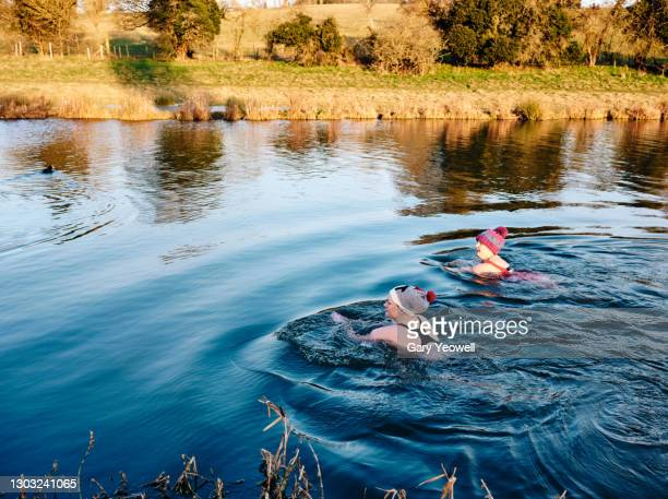open water river swimmers - cold temperature stock pictures, royalty-free photos & images