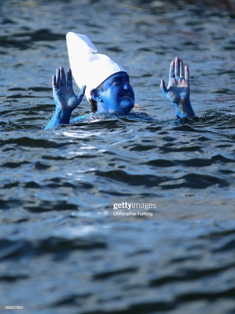 Open water swimmer Rebecca Jarre, dressed as a smurf, braves the chilly temperatures during The Big Chill open swimming event in Lake Windermere on February 2, 2013 in Windermere, England. The Big Chill swimmers plunged into Lake Windermere, where the water temperature was an average of four degrees celsius, for a series of events including relays, endurance and fun swims.