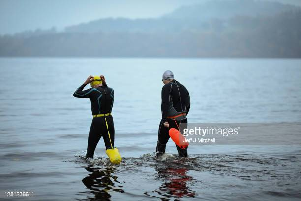 Open water swimming enthusiasts enjoy an early morning swim in Loch Lomond on October 20, 2020 in Trossachs, Scotland. A new study from the UK...