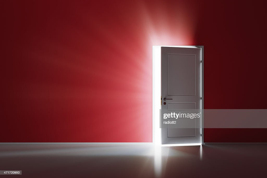 Open white door on red wall