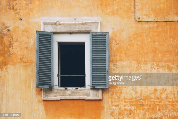 open window against and old wall - window stock pictures, royalty-free photos & images