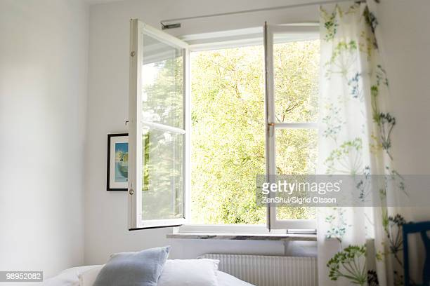 open window in bedroom - window stock pictures, royalty-free photos & images
