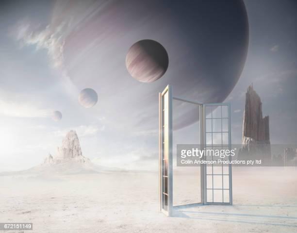 Open window on planet under moons