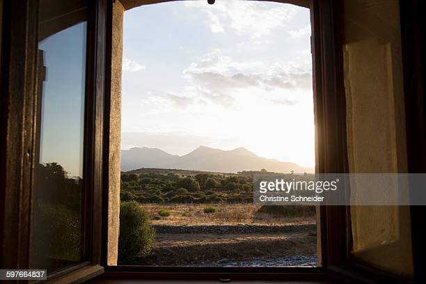 Open window view of rural landscape at dusk, Calvi, Corsica, France