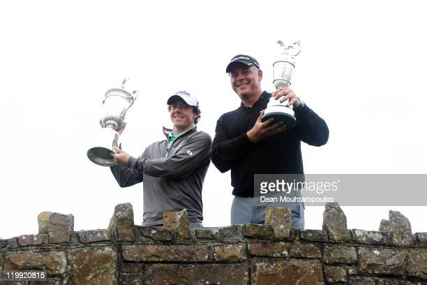 S Open Winner Rory McIlroy of Northern Ireland and 2011 Open Championship Winner Darren Clarke of Northern Ireland pose for the media during the Pro...